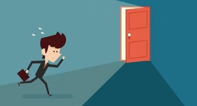 Running businessman and open door